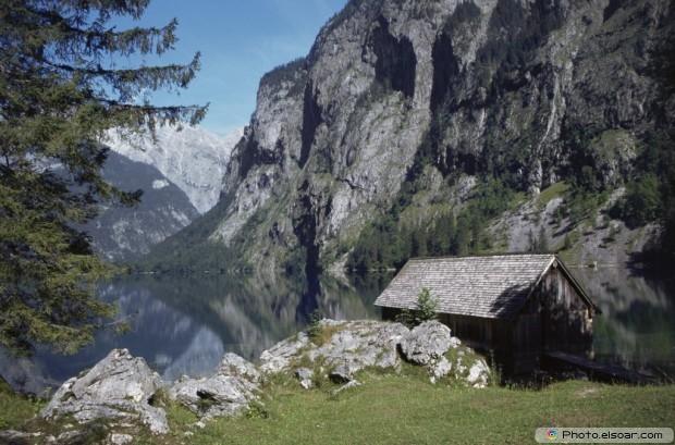 A Log Cabin Next To Upper Lake