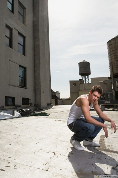 A Young Man Crouching