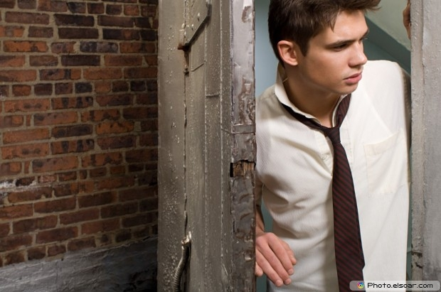 A Young Man In A Doorway