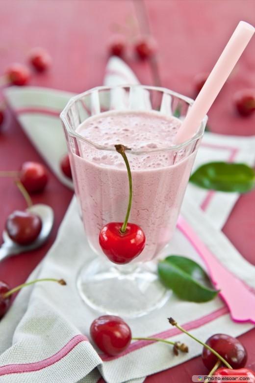 A glass of cherry milkschake