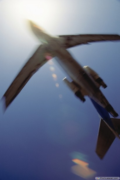 Airplane Between The Sun And Sky