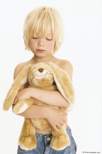 Blonde Boy With A Small Teddy