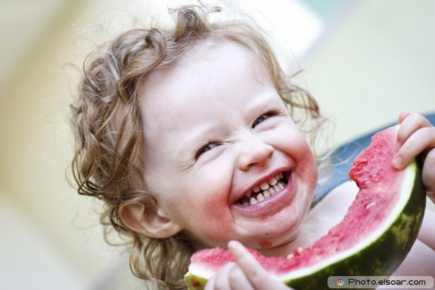 Cheerful Toddler With Melon