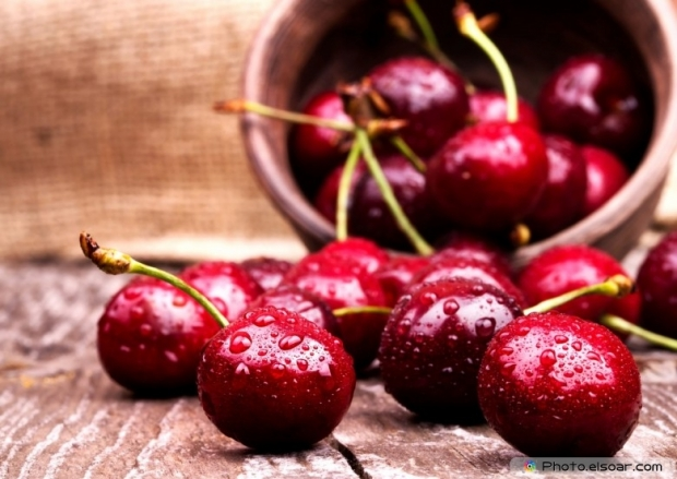 Cherries With Water Drops On Table