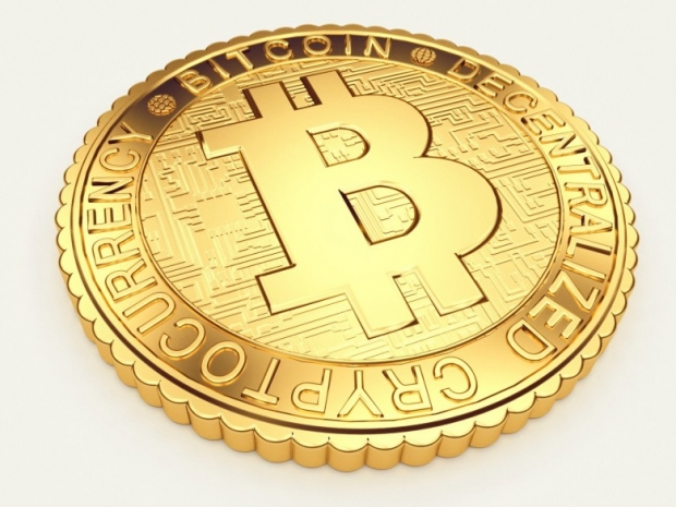 Close-up image of golden Bitcoin coin