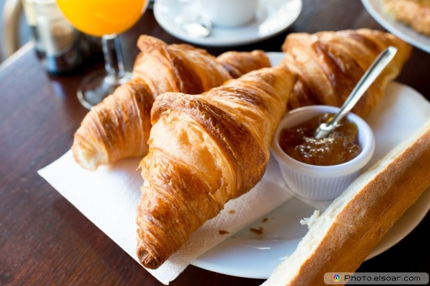 Coffee And Croissants On A White Dish