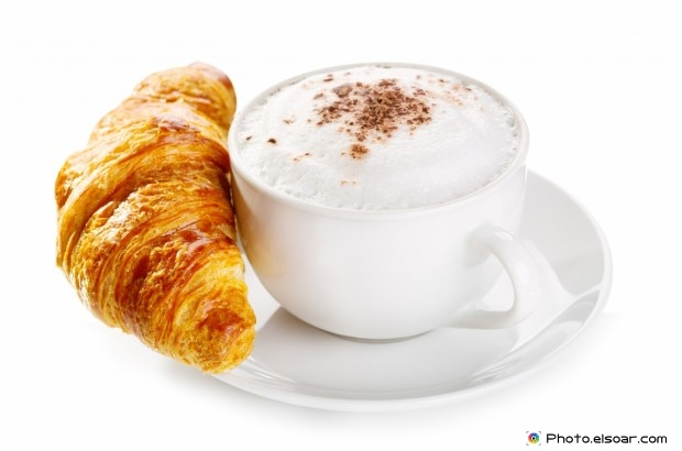 Croissant And White Cup Of Coffee