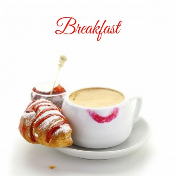 Cup of coffee. croissant. strawberry jam