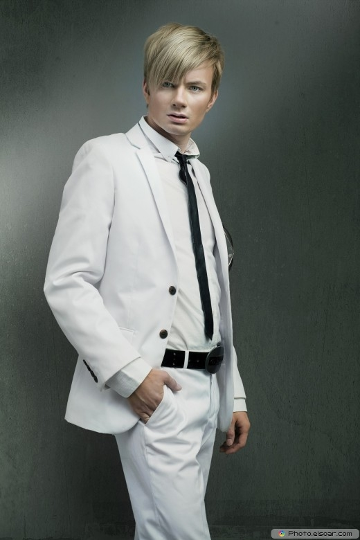 Fashion style photo of a man wearing white suit