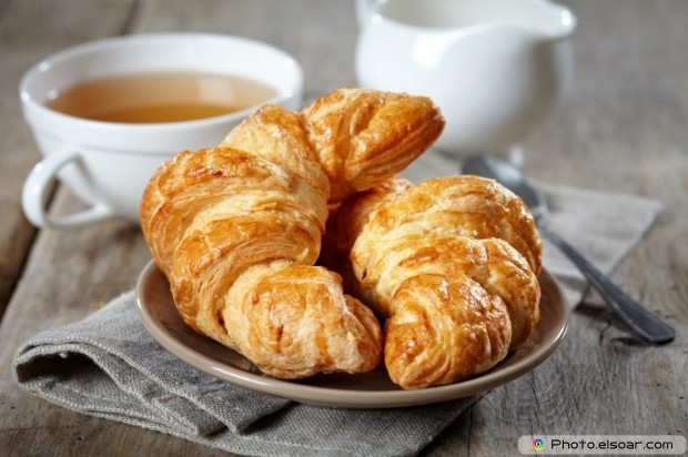 Fresh Baked Croissants With Two Cups