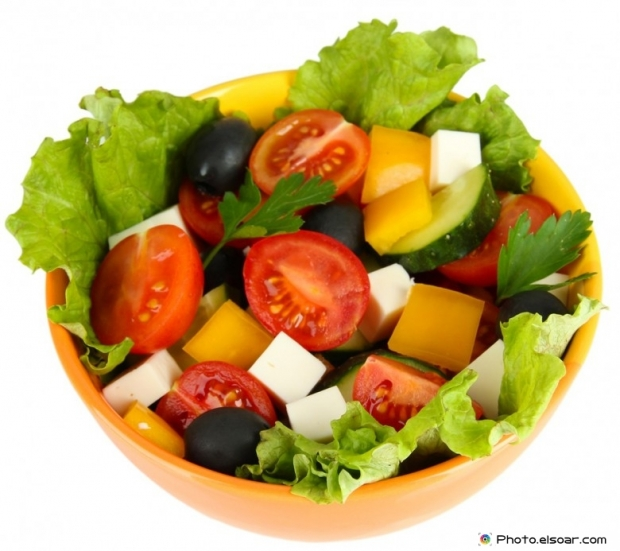 Fresh salad with cheese on white