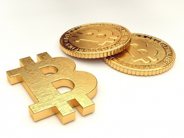 Golden Bitcoin sign and a stack of coins
