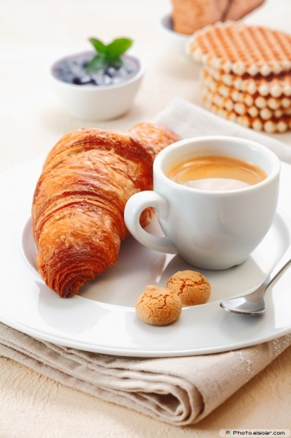Golden Croissant With A Cup Of Rich Espresso