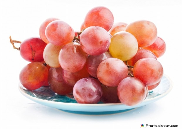 Grapes On A White Dish