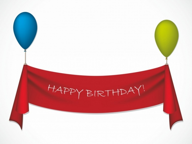 Happy birthday ribbon hanging on balloons