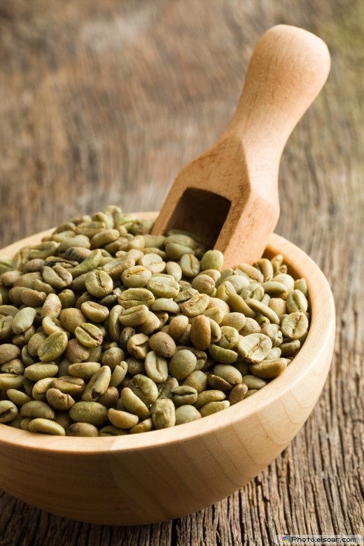 Image. Green coffee beans with wooden scoop