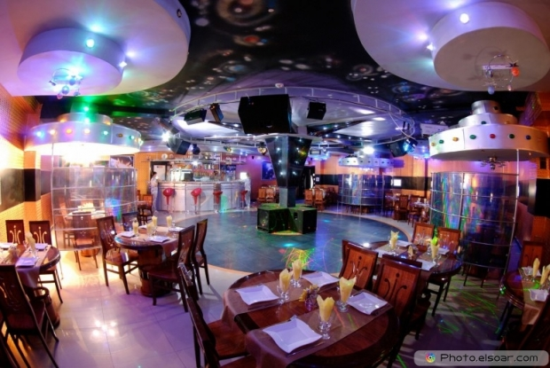 Night club interior with bar and tables