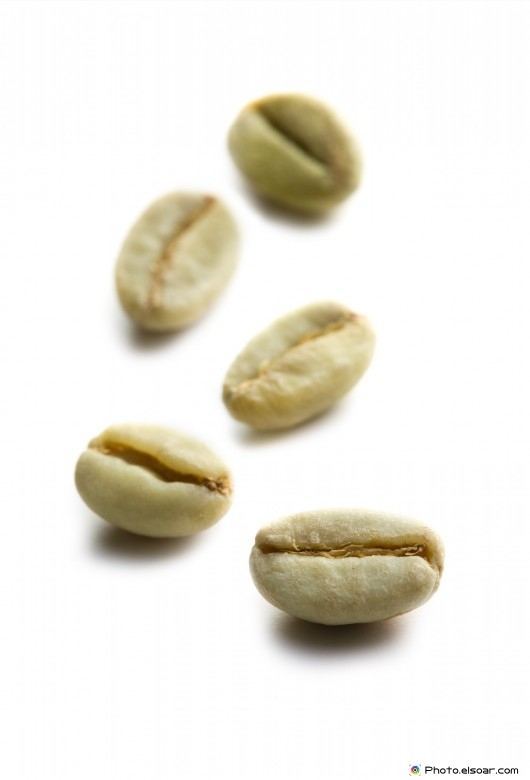 On white. green coffee beans