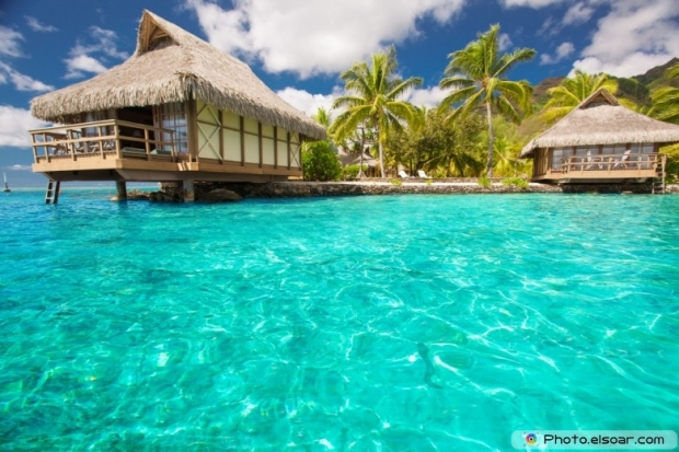 Overwater bungalows with amazing blue lagoon