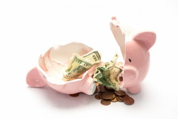 Piggy bank broken with money