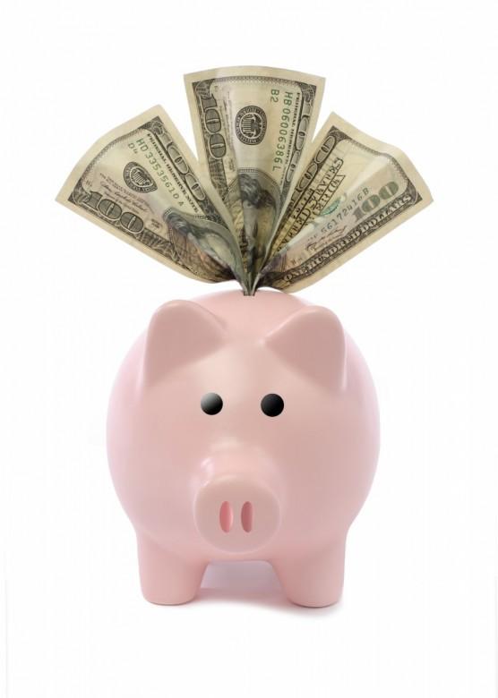 Piggy bank cutout with three hundred dollar bills