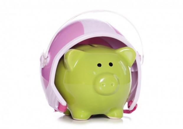 Piggy bank wearing a crash helmet studio cutout