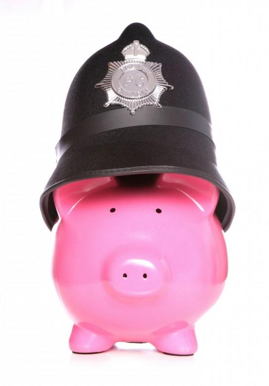 Piggy bank wearing police hat