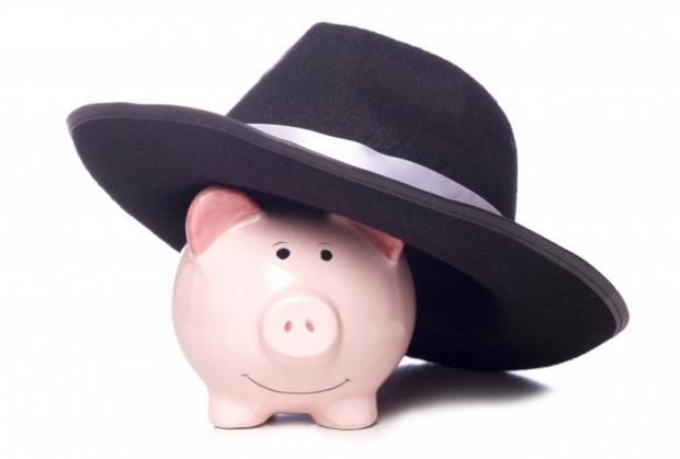 Piggy bank with mafia hat studio cutout