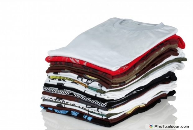 Row of colorful cotton t-shirts. Clothes background