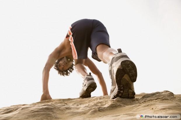 Runner climbing on rocks