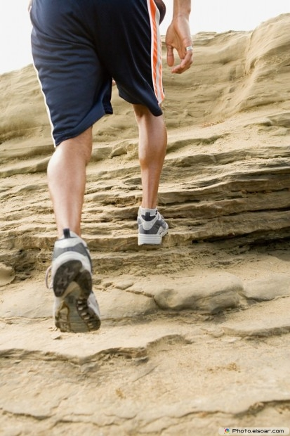 Runner climbing rocks