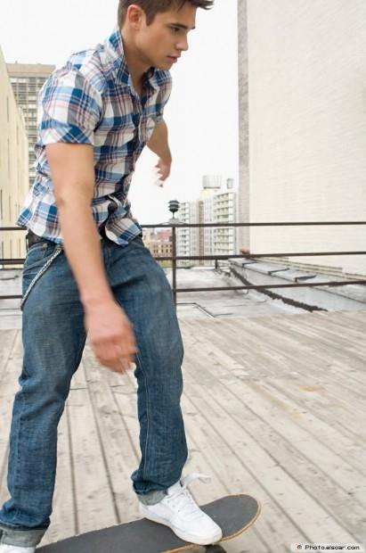 Stylish Young Man Skateboarding
