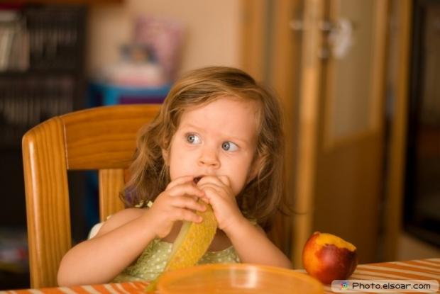 Toddler Eats Melon