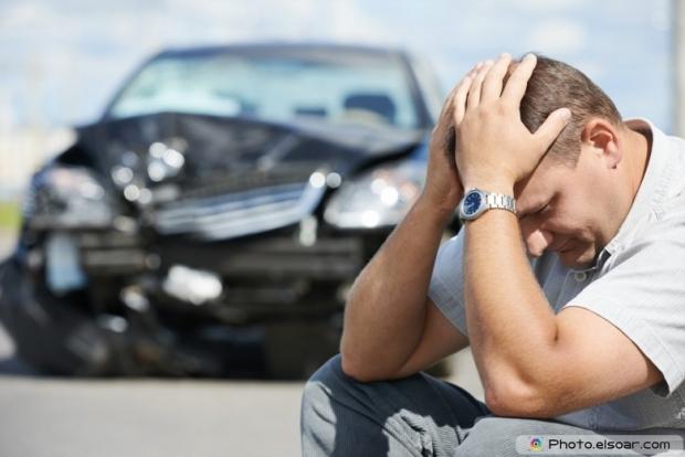 Upset driver man in front of automobile crash car collision accident
