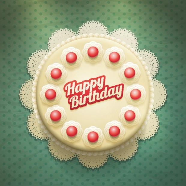 White birthday cake with cream and cherries