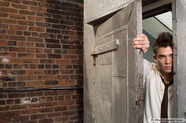 Young Man In A Doorway