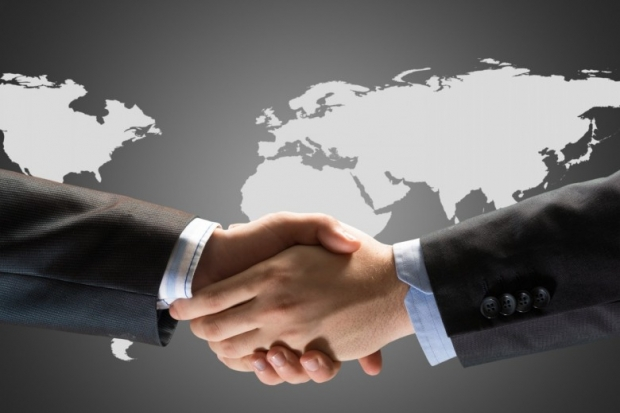 two businessmen shaking hands photo A
