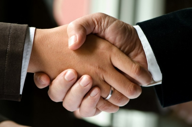 two businessmen shaking hands photo B