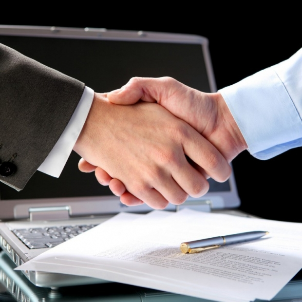 two businessmen shaking hands photo D