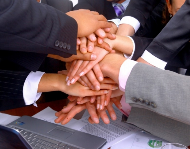 two businessmen shaking hands photo E