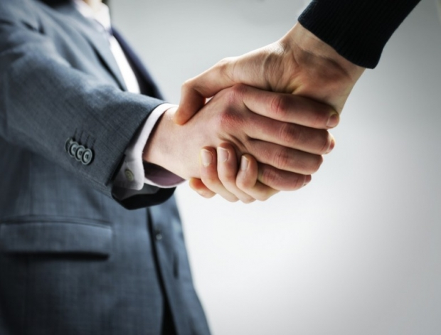 two businessmen shaking hands photo F