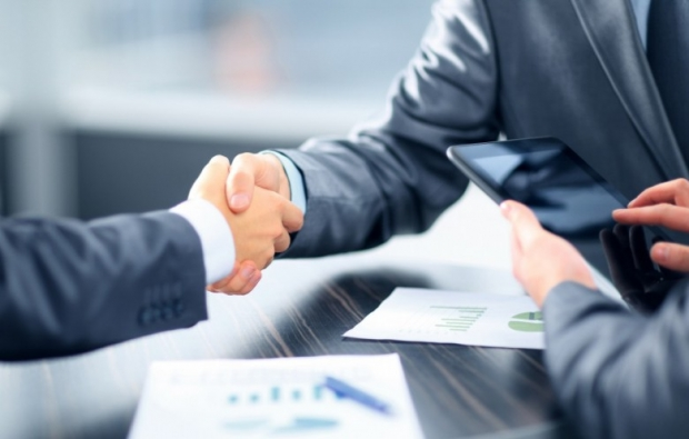 two businessmen shaking hands photo G